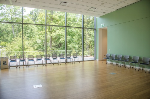 Photo of the light-filled Student Wellness Center Room 148 and chairs in the room