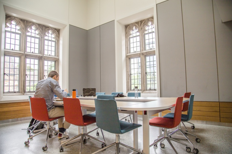 Photo of Brodhead Center Room 248 showing conference table, chairs, windows, and one person at table