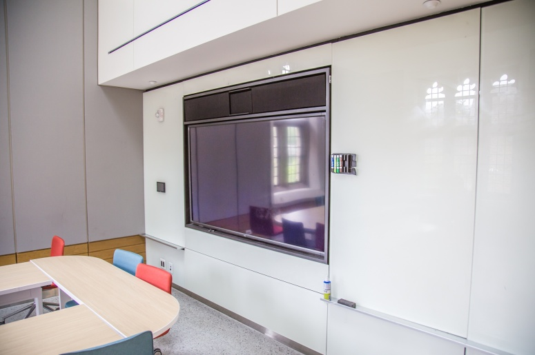 Photo of Brodhead Center Room 248 showing close up of projection screen and whiteboard